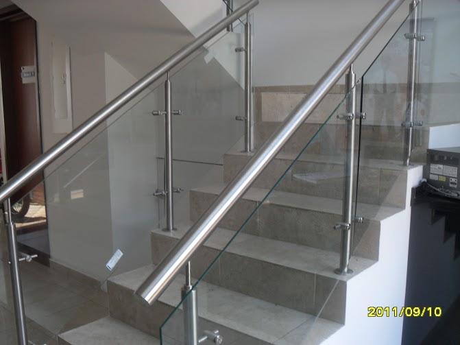 Glassteel sistemas vidriados for Barandas de vidrio y acero